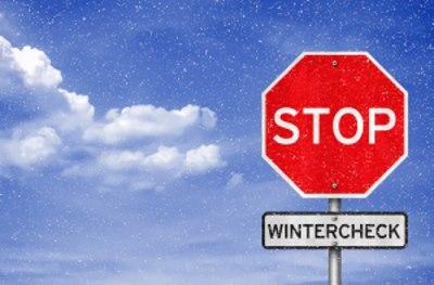 Stopschild und Wintercheck-Schild